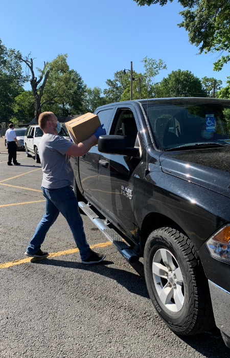 Man loading food box into truck